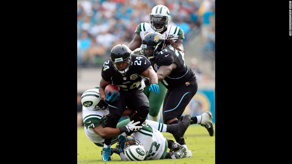 Montell Owens of the Jaguars runs for yardage during the game against the New York Jets on Sunday.