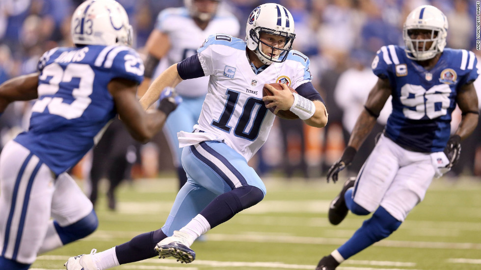 Titans quarterback Jake Locker runs with the ball against the Colts on Sunday.