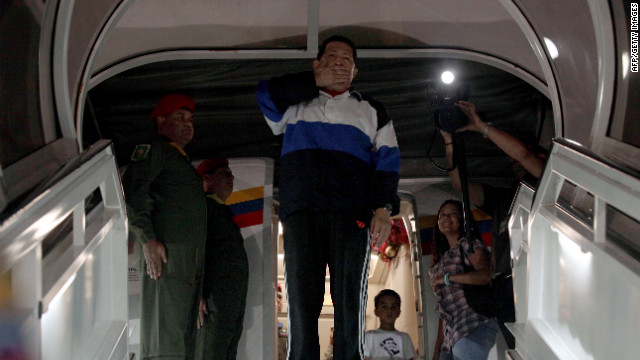 Handout picture provided by the Venezuelan Presidency showing Venezuela's President Hugo Chavez (C) blowing kisses from the plane stairs just before departing to Cuba, on December 10, 2012 in Caracas. Chavez left for Cuba early Monday to undergo new cancer surgery that the Venezuelan leftist president admitted was urgently needed to fight the deadly disease.