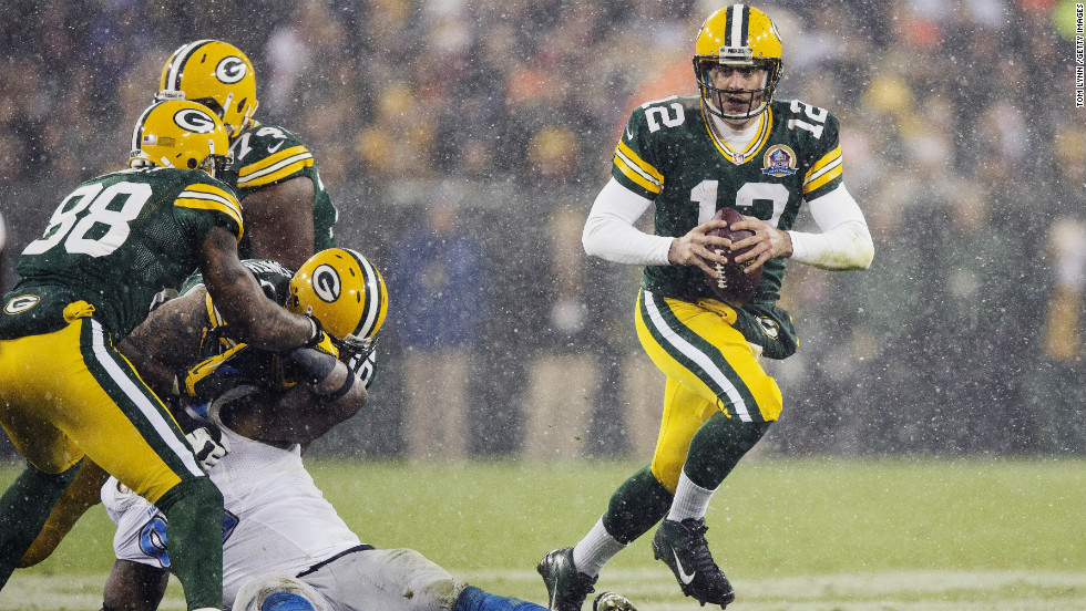 Green Bay Packers quarterback Aaron Rodgers scrambles out of the pocket and looks for an open receiver in a game against the Detroit Lions at Lambeau Field on Sunday, December 9, in Green Bay, Wisconsin.