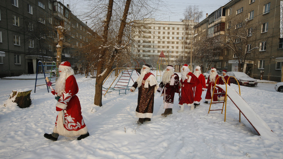 "Costumed participants of the annual ""Best Father Frost"" contest from different city districts make their way through a courtyard in Krasnoyarsk, Russia, on Monday, December 10."