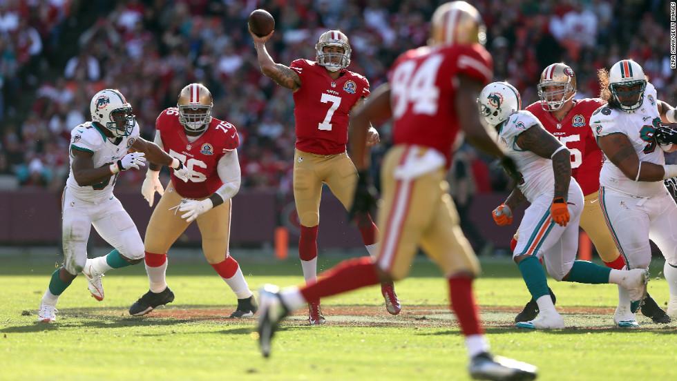 49ers quarterback Colin Kaepernick passes against the Dolphins on Sunday.