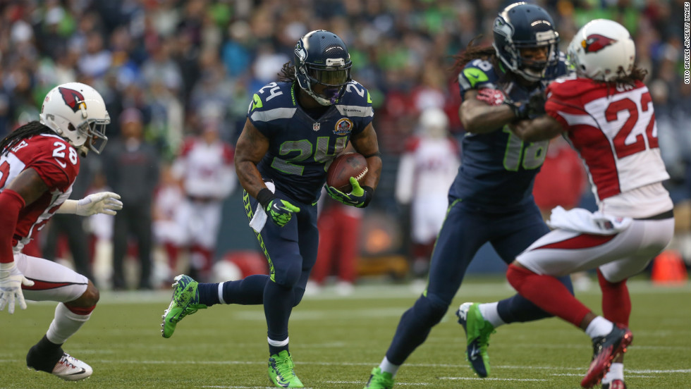Running back Marshawn Lynch of the Seahawks rushes for a touchdown against the Cardinals on Sunday.
