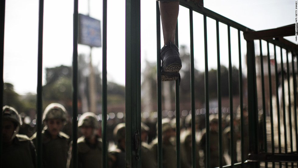 A young protester climbs atop a barricade erected by the Egyptian army on December 11. There were no incidents of violence and soldiers held the line as a couple of hundred protesters pressed up against waist-high crowd barriers.