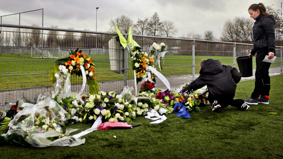 People lay flowers for Nieuwenhuizen at the Buitenboys clubhouse in Almere on December 9, 2012. Eight people have been arrested in connection with the attack, which came following a match against Amsterdam's Nieuw  Sloten.