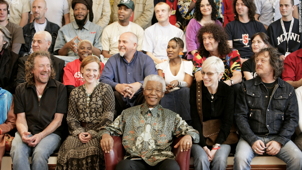 "The ""46664 Arctic"" benefit concert was held in Tromso, Norway, on June 11, 2005. 46664 was Mandela's identification number in prison. Here, artists who performed at the event surround him."
