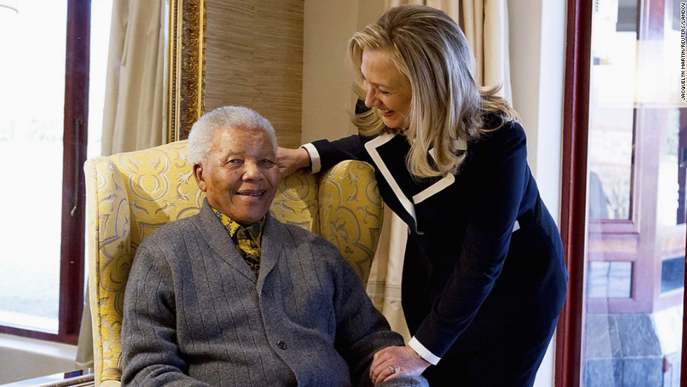 Then-U.S. Secretary of State Hillary Clinton meets with Mandela at his home in Qunu, South Africa, on August 6, 2012.