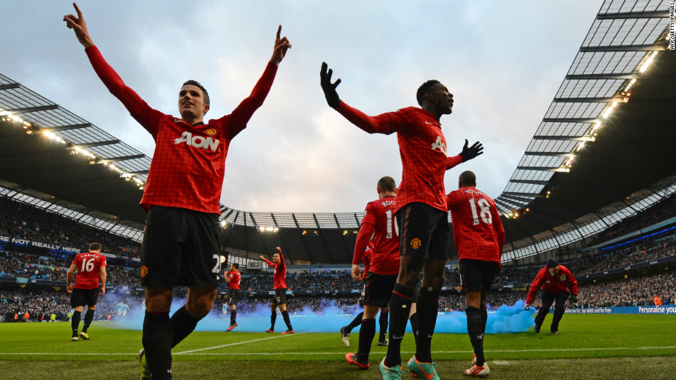 United's players celebrate Robin Van Persie's decisive late goal in a 3-2 victory -- which was met by missiles and smoke bombs hurled by City supporters.