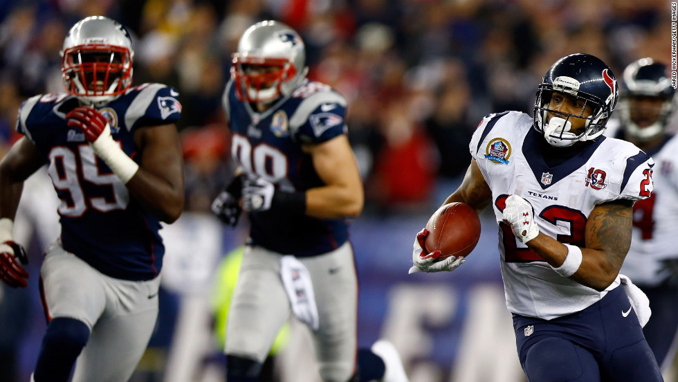 Arian Foster of the Houston Texans runs the ball Monday against the New England Patriots.