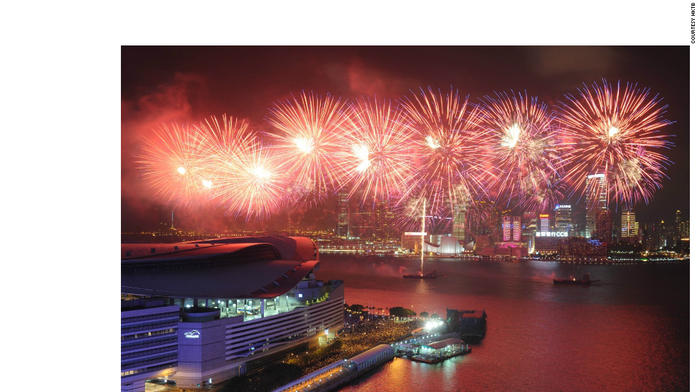 Firework's light up Hong Kong's Victoria Harbour.  This year will see the city's midnight fireworks display journey across town for the first time, beginning out at the sea and moving along Victoria Harbour to the Hong Kong Convention and Exhibition Centre in Wan Chai.
