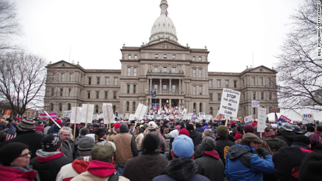 Sweeping law limits union power in Michigan