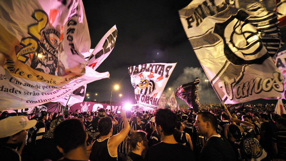 Some 15,000 Corinthians supporters waved banners, set off fireworks and blocked roads at Sao Paulo's main airport as the team set off for Japan.
