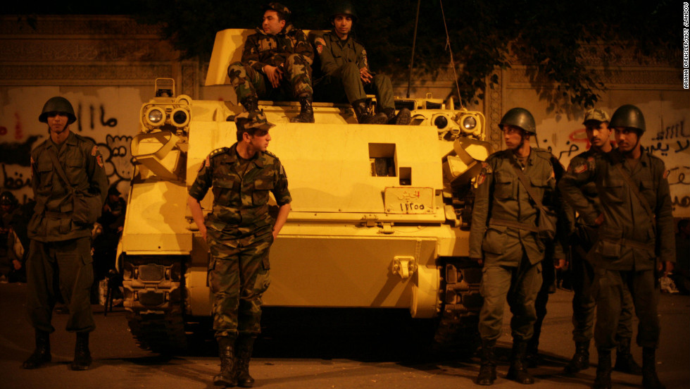 Security forces stand guard in front of the presidential palace in Cairo on December 11.