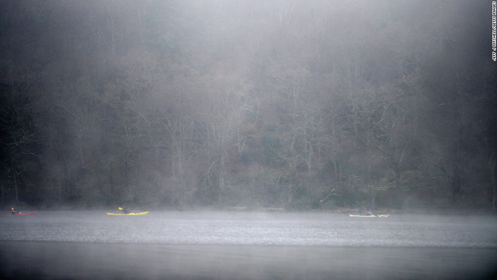 Boaters make their way past Inchtavannach Island on Loch Lomond on December 12 in Loch Lomond, Scotland.