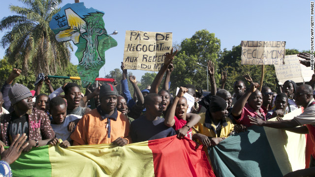 A man holding a banner that reads 'No negotiation with rebels' joins thousands of others in Bamako on December 8, 2012.