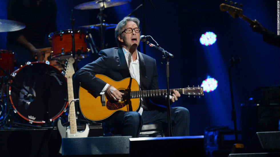 "Eric Clapton performs at Madison Square Garden. Concert organizers said the event was accessible to 2 billion people worldwide, through television and websites. ""We are having high donation volume on the web,"" they said on the concert's Twitter page late Wednesday."