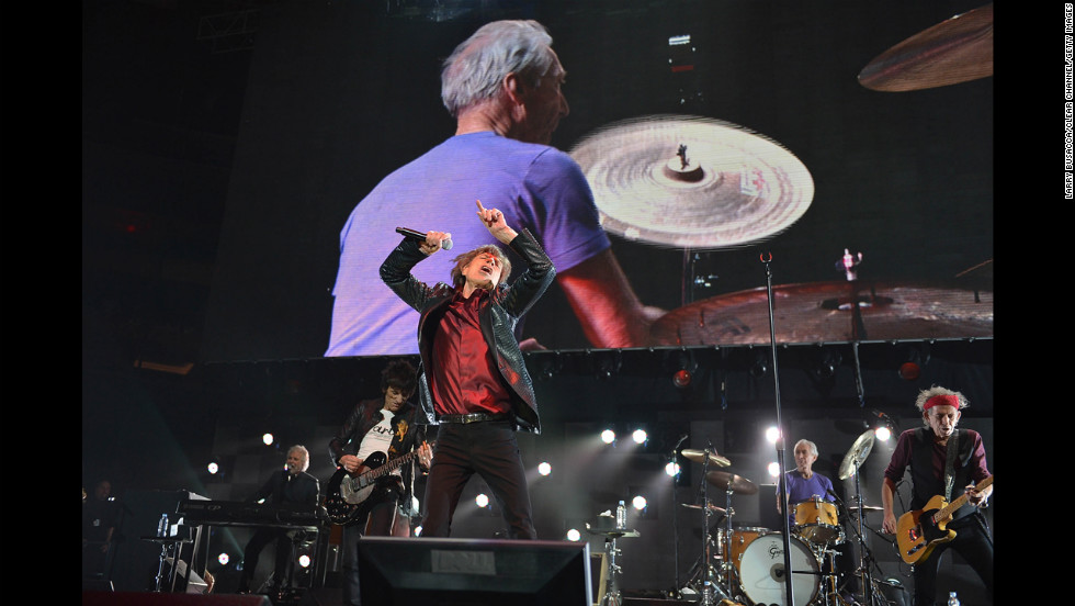 Ronnie Wood, Mick Jagger, and Keith Richards of The Rolling Stones perform at the benefit.