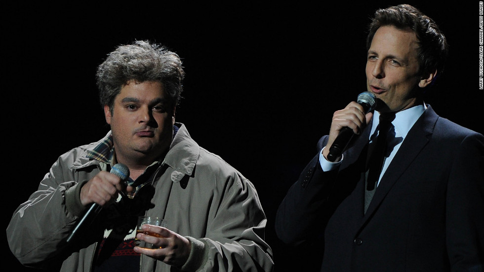 "Bobby Moynihan and Seth Meyers of ""Saturday Night Live"" address the crowd."