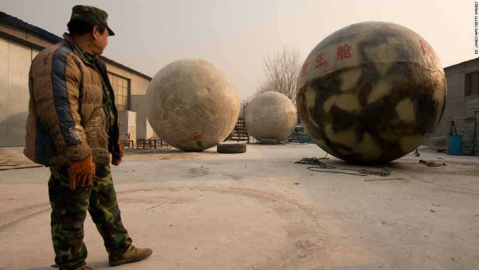 A worker looks at the pods. The spheres are airtight and can float on water.