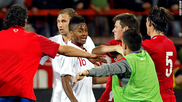 Numerous scuffles broke out in Krusevac after England sealed qualification for next year's European Under-21 Championship.