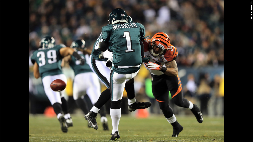Dan Herron of the Cincinnati Bengals blocks a punt by Mat McBriar of the Philadelphia Eagles in the first quarter on December 13.