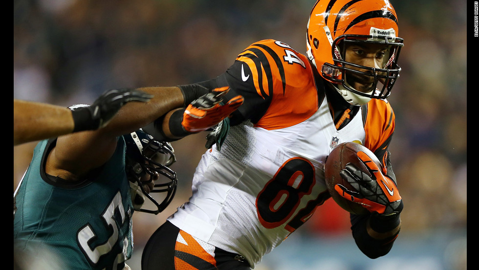 Jermaine Gresham of the Cincinnati Bengals carries the ball as DeMeco Ryans of the Philadelphia Eagles tries to tackle him on December 13.