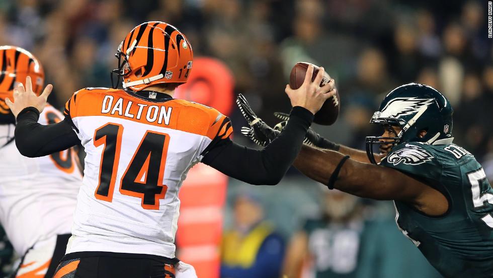 Brandon Graham of the Philadelphia Eagles knocks the ball from Andy Dalton of the Cincinnati Bengals on Thursday, December 13, at Lincoln Financial Field in Philadelphia.