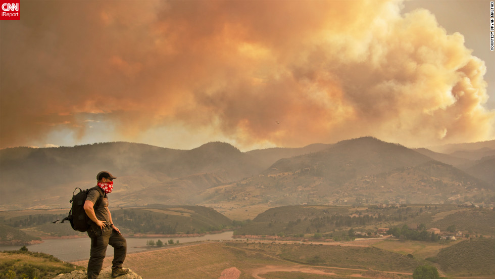 "June's High Park fire, caused by extreme drought conditions, could be seen from the Horsetooth Reservoir in Larimer County,<a href=""http://ireport.cnn.com/docs/DOC-804593""> Colorado.</a> ""Climbing to this vantage point afforded me the opportunity to capture the fire crew on film at eye level as they flew by, and to look down into the heliport,"" said Bryan Maltais. ""I could also also photograph the unique atmospheric conditions that the fire created."""