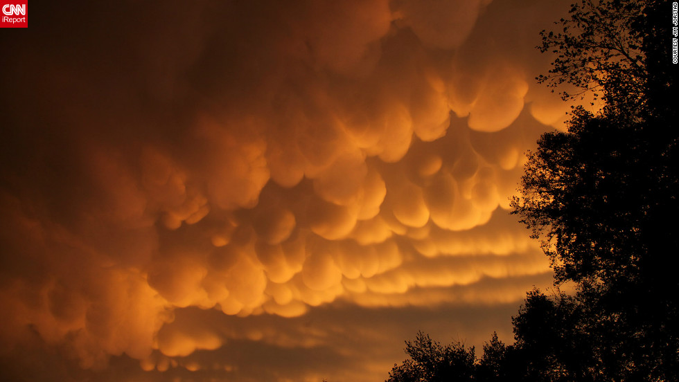 "Rare cloud formations, called <a href=""http://ireport.cnn.com/docs/DOC-837418"">mammatus</a>, were spotted in La Crosse, Wisconsin in September. The name ""mammatus"" comes from the Latin word manna, or breast. ""After the storms rumbled through, I saw a yellow orange glow out the window,"" said Jim Jorstad. ""I then grabbed my camera, began driving several miles up the hill, stopping to take photos along the way."""