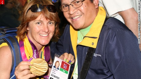 """Gabriel Dominise of Rainham, England, can thank a last minute decision to switch tube trains in London for his best moment of the year.  He entered the subway one summer morning, during the Paralympic Games, to find Liesl Tesch, Australian Paralympic sailing gold medallist, sitting in the same carriage.  """"She was very friendly and happy showing her gold medal to the passengers,"""" he said. """"Everyone scampered for [their] turn of the photo shoot opportunity. She put the medal around my neck and asked for my phone and took the picture herself.""""  He said it was moment of the year for him because of the unique atmosphere of London during the summer games. """"I consider this my best moment, because this occasion was so rare for me -- maybe it will not happen again in my lifetime,"""" he said."""