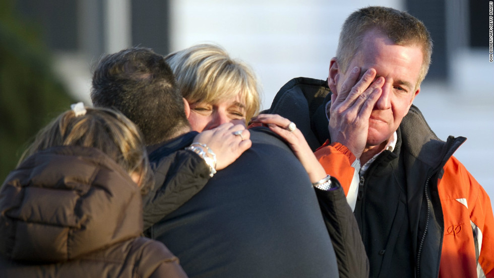 Distraught people leave the fire station after hearing news of their loved ones from officials on Friday.