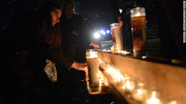 People gather for a prayer vigil at St Rose Church on December 14.