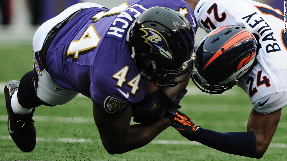 Full back Vonta Leach of the Ravens is hit by cornerback Champ Bailey of the Broncos in the first quarter on Sunday.