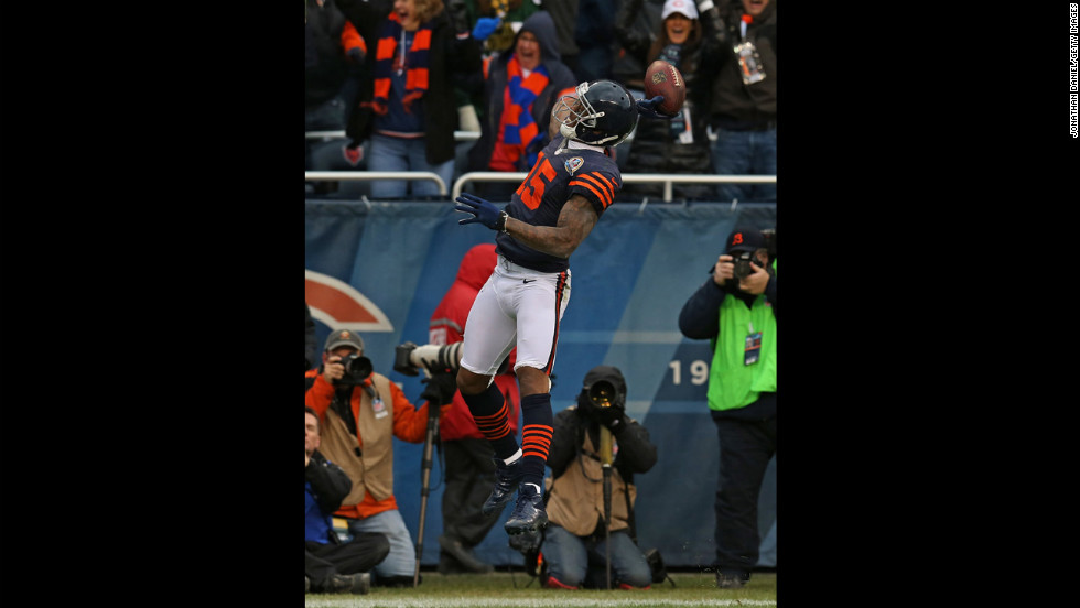 Brandon Marshall of the Bears throws the ball into the stands after scoring a touchdown against the Packers on Sunday.
