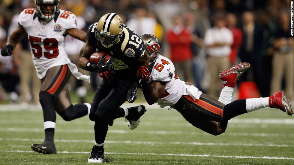 Marques Colston of the Saints slips a tackle by Lavonte David of the Buccaneers on Sunday.