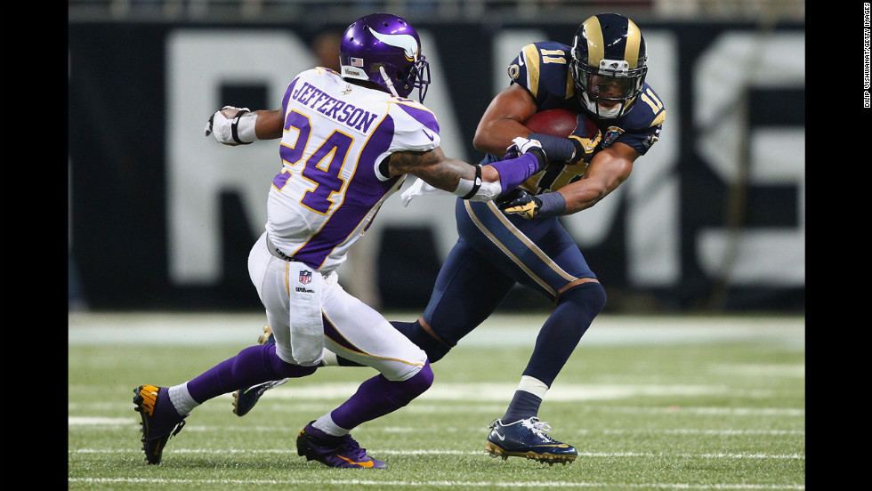 A.J. Jefferson of the Vikings attempts to tackle Brandon Gibson of the Rams on Sunday.