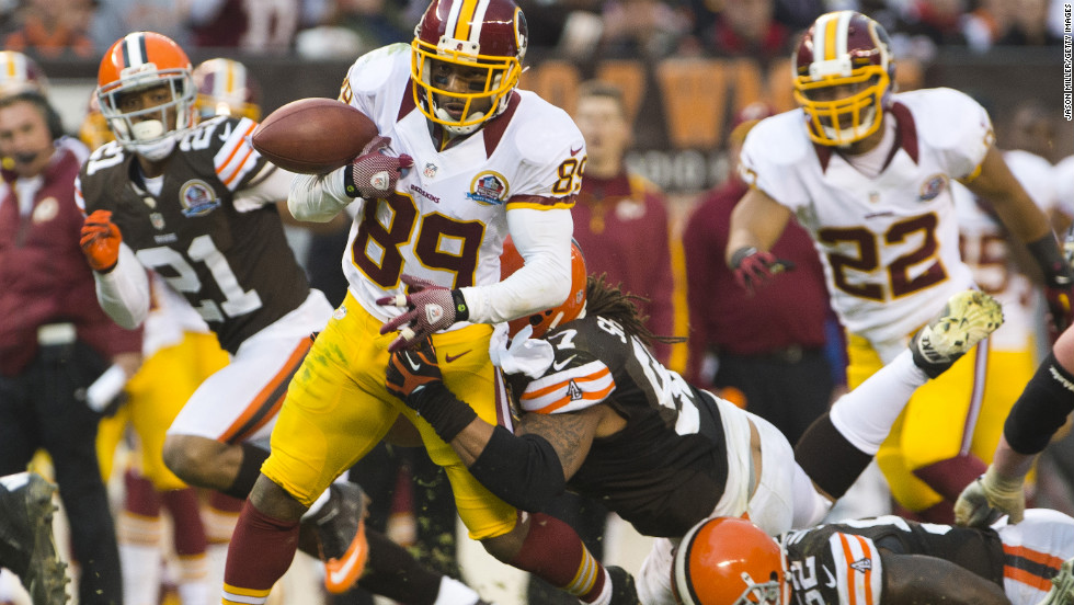 Wide receiver Santana Moss of the Redskins fumbles the ball during the second half against the Browns on Sunday.
