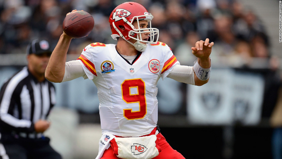Brady Quinn of the Kansas City Chiefs drops back to pass against the Oakland Raiders in the first quarter at Oakland-Alameda County Coliseum on Sunday, December 16, in Oakland, California.