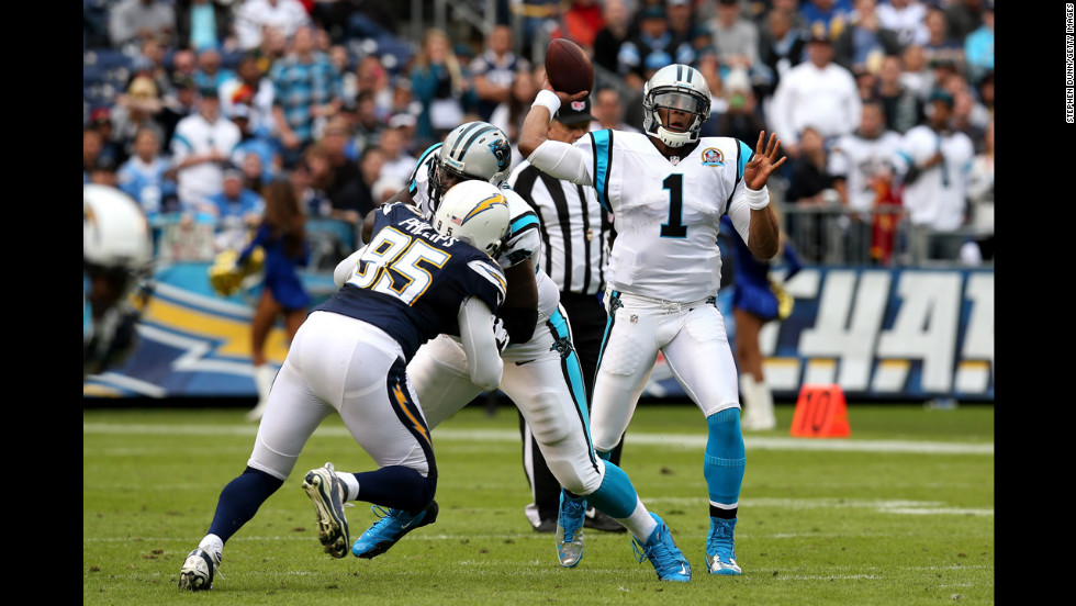 Quarterback Cam Newton of the Panthers throws a pass over linebacker Shaun Phillips of the Chargers on Sunday.
