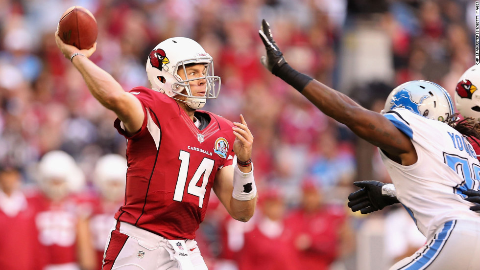 Quarterback Ryan Lindley of the Cardinals throws a pass under pressure from defensive end Willie Young of the Lions on Sunday.