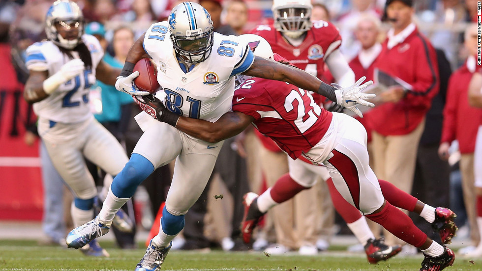 Wide receiver Calvin Johnson of the Lions runs with the football after a reception against cornerback William Gay of the Cardinals on Sunday.