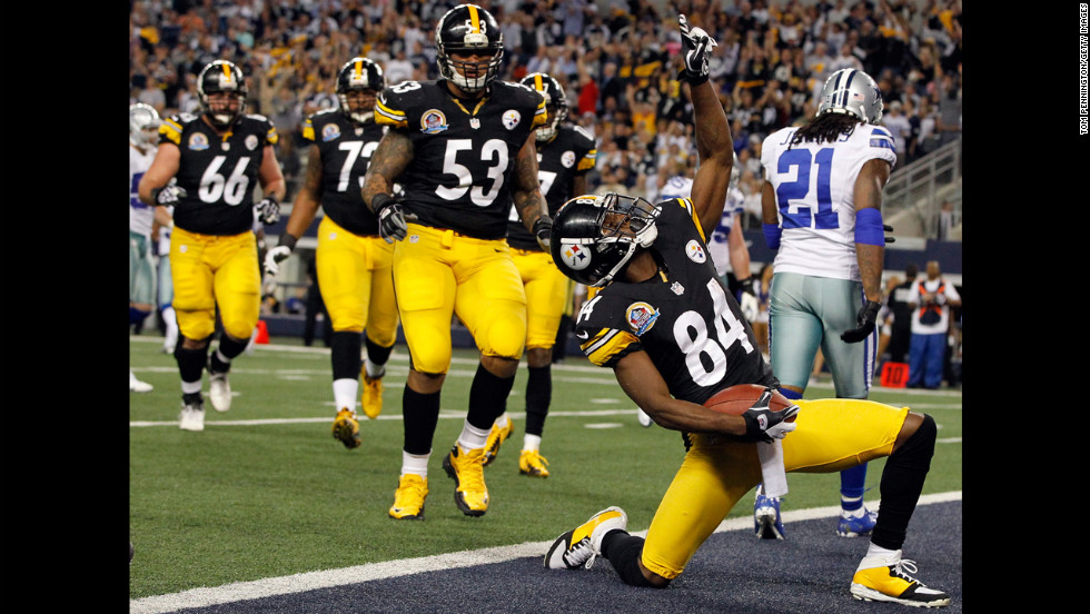 Antonio Brown of the Steelers celebrates after scoring a touchdown against Mike Jenkins of the Cowboys on Sunday.