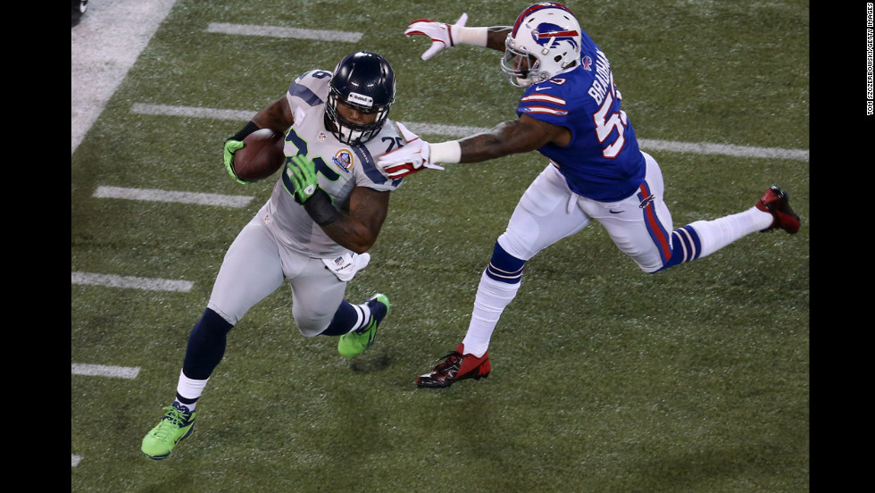 Michael Robinson of the Seattle Seahawks carries the ball as Nigel Bradham of the Buffalo Bills closes in for a tackle at Rogers Centre on Sunday, December 16, in Toronto.
