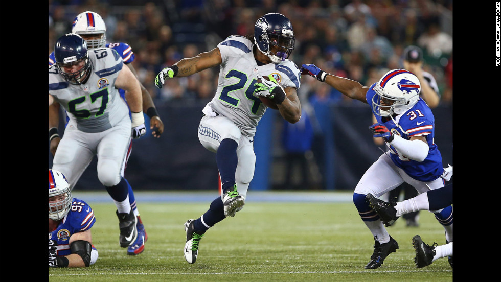 Marshawn Lynch of the Seahawks carries the ball as Jairus Byrd of the Bills attempts to tackle him on Sunday.