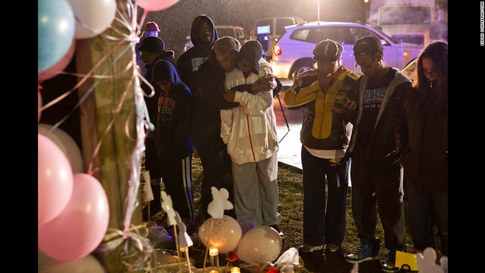 Young people mourn at Newtown High School before a memorial service attended by President Obama on Sunday, December 16.