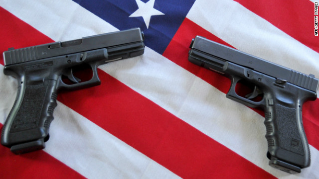 Two Glock .40 caliber semiautomatic handguns are displayed in Woodbury, Minnesota on May 28, 2011.