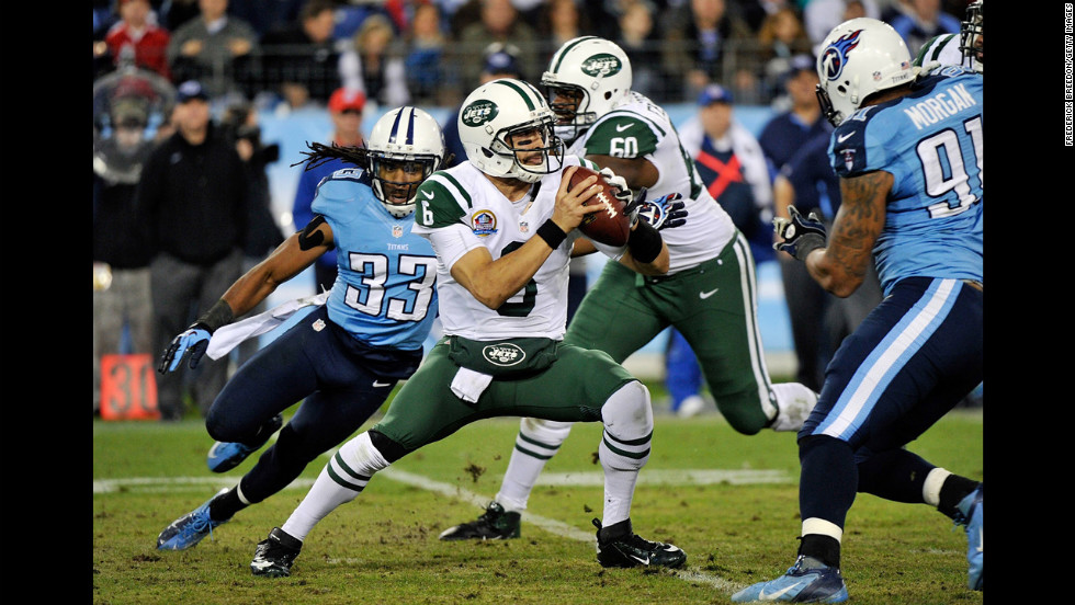 Jets quarterback Sanchez is pressured by Titans safety Michael Griffin on Monday.