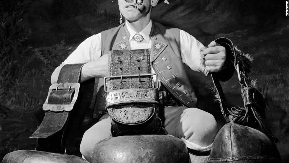 An Alpiner with three large cow bells, which produce that sombre rhythmic sound, at a traditional bell-swinging festival in 1955.