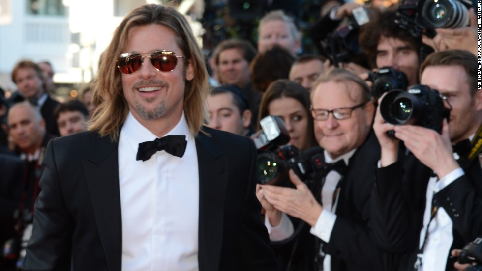 "CNN's readers have clearly forgiven ""Killing Them Softly"" star Brad Pitt for that Chanel commercial he did this fall. When not confusing us with vague statements about perfume, he's been focused on political causes, not unlike his fiancee, Angelina Jolie."