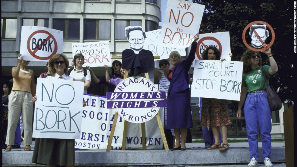 People rally against the nomination of Bork as a Supreme Court justice.